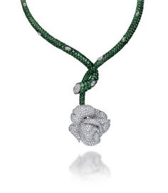 Italian jeweler Picchiotti built on the theme of rose as the inspiration for an extraordinary blossom, in this rose necklace with a tsavorite cascade and an all pavé-set diamond rose head as a centre.