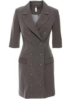 Se nu:Underbar klänning för jobb och fritid! Tidlös businessklänning med slag och tvåradig knappslå. Längd ca 90 cm i storlek 38.