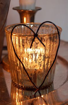 Simple heart... just some bailing wire!  Fits my sense of decor....