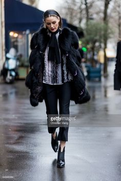 Olivia Palermo wearing a black fur coat outside Giambattista Valli on March 6, 2017 in Paris, France.