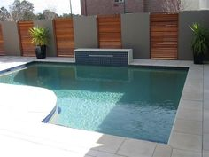 Alternating panel walls in outdoor pool.