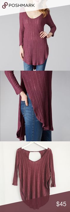 """{free people} Astoria ribbed tee in Sangria ✨Free People We the Free Astoria Hacci Split Ribbed Tee in Sangria ✨  ➳ NWT - no flaws ➳ features 3/4 sleeve, sheer ribbing, fold over side slits, shirttail hem, keyhole back ➳ approx 29"""" long shoulder to front hem, about 21"""" armpit to armpit ➳ cotton & polyester  ☞ size XS  ❥ no trades ❥ please check photos & ask all questions prior to purchase Free People Tops"""