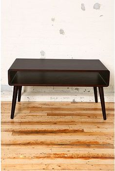 I saw this on Lay Baby Lay, and I like the idea of using a coffee table as a kids' play table.