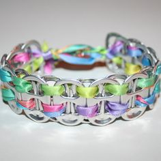 Made this one today! 26 soda can tabs  (filed to remove sharp edges) and 3 feet of 3/8 inch gradiant rainbow ribbon. Used this particular Etsy link as a guide because of all the close up pics. Very easy to make and super cute!