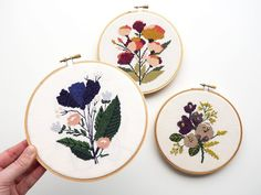 These three cross stitch, hand embroidered, floral hoops were made by Floral Hoops, Cross Stitch Flowers, Embroidery Thread, Made By Hands, Needlepoint