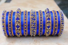 £17 Complete 50 Pieces Bangle Set. Stunning Royal Blue Bangle Set.    Whilst this is a must have for any bangle collection, the colour combination makes this THE IDEAL WEDDING set.  #Bollywoodstyle #bellydancerjewelry #bangles #bracelets #indianfashion #saree #allthingsblue #royalblue #blue #holiday #lehnga #indianbride