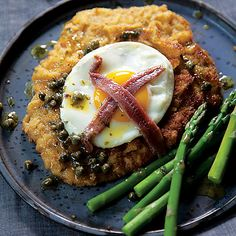 Holsteiner Schnitzel: Crisp-fried veal topped with luscious egg, salty anchovies and capers. A colorful and traditional regional German main dish.