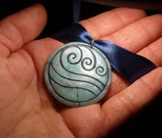 The symbol of the watertribe engraved in the necklace of the brave waterbender Katara, from the series Avatar - The last Airbender handsculpted