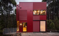 New Zealand's Crosson Architects create a bright red home in a suburb of Auckland