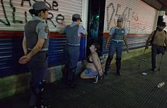 BRAZIL, Sao Paulo : Policewomen arrest a woman during a protest against the government's expenditure for the 2014 FIFA World Cup in Sao Paulo, Brazil on February 22, 2014. AFP PHOTO / NELSON ALMEIDA