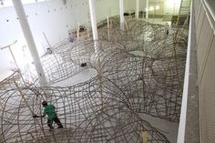 Artist Henrique Oliveira Constructs a Cavernous Network of Repurposed Wood Tunnels at MAC USP | SCULPTURES | Scoop.it