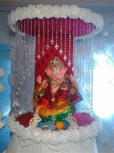 Ganpati Decoration Ideas Ganesh Pooja is part of Ganapati decoration - Get innovative, creative and fresh Ganpati decoration ideas and tips in here Take a look at these cool ideas and learn how to do Ganpati decoration at home Ganpati Decoration Design, Mandir Decoration, Ganapati Decoration, Flower Decoration For Ganpati, Diwali Decorations, Stage Decorations, Festival Decorations, Flower Decorations, Housewarming Decorations