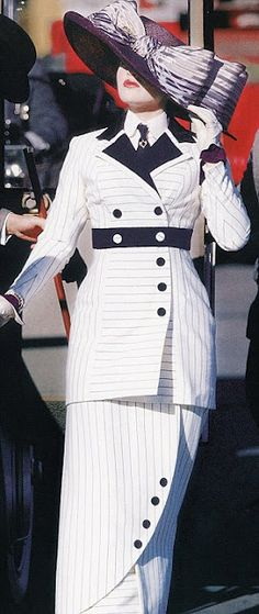 Kate Winslet as Rose DeWitt Bukater in Titanic (1997) wearing a black and white dress by Deborah L. Scott.