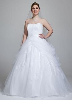 A modern twist on the traditional ball gown, this romantic Tulle gown has it all. It's all in the details in this stunning wedding dress featuring a lace-up back, side swags and lace appliqués. Side swags on skirt provide a voluminous effect, Wedding Dresses Plus Size, Princess Wedding Dresses, Plus Size Wedding, Bridal Dresses, Wedding Gowns, Party Dresses, Wedding 2017, Wedding Bride, Wedding Planner