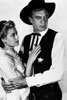Grace Kelly and Gary Cooper in High Noon (1952.) I dated a girl that looked like her, all the men liked her too-lol.