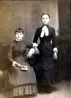 'Victorian era death photo. It was common in the Victorian era to photograph loved ones after death as a keepsake. Whenever I see these I am struck that the living seem unaffected by their grief. Sometimes I have to look twice to realize which subject is dead. In this one, it is the girl standing. She propped up with a stand.'