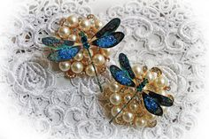 This listing is for 2 beautiful Peacock Feather Dragonflies. They make a wonderful embellishment for scrapbooking, cardmaking, tags, mini albums, weddings, altered item applications, or any thing your imagination can dream up. These dragonflies are made from heavy duty, Archival Safe cardstock and have glitter painted accents all over, hand tinted German glitter glass accents on their wings and crystal accents on the body. I love taking hikes down by the lakes at my house everyday, and in…