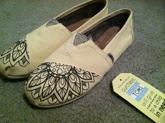 Natural canvas authentic TOMS shoes with hand-drawn flower design. Size 7.5 in womens. Done using waterproof ink (although TOMS themselves are