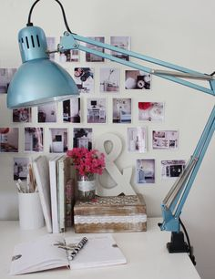spraypainted ikea tertial lamp. Also love the photo cluster and vignette behind.