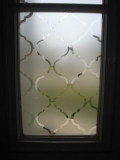 Make a stenciled privacy door.  I would love to do this on my shower walls in the master bath. This is a lovely design.