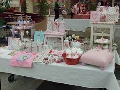 craft fair stall - love the little footstool cushion on the right and the cake stand