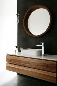 Floating timber vanity with shadow lines and stone bench top. #bomboracustomfurniture #floatingtimbervanity #timbervanity