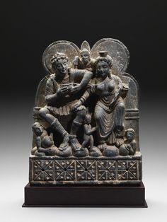 Hariti and Pancika Grey Schist Ancient Region of Gandhara, circa 2nd Century 13 in / 33 cm