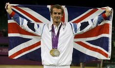 Andy Murray of Britain poses with his two medals during the presentation ceremony for tennis mixed doubles at the All England Lawn Tennis Club during the London 2012 Olympic Games August 5, 2012.