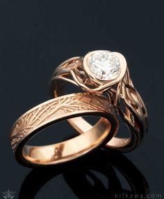 A bridal ring set that showcases the beauty of nature and symbolizes your eternal love for each other. The Embracing Tree Branch Engagement Ring has a 1 carat round diamond solitaire and was done in 14k rose gold like the Tree of Life Wedding Band. Design your set in the metal and stone you want!