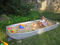 A sandbox made from an old boat. Such a good idea!