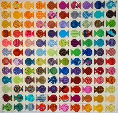 Here is the fish quilt top without borders or cats. It measures roughly 52 by 56 inches. I'm quite pleased with the rainbow layout. It's v...