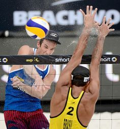 FIVB Beach Volleyball Grand Slam Nicholas Lucena of the U.S. spikes the ball against Pedro Solberg Salgado of Brazil.