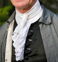 Plainer cut 18th century men's wear. Great pic for showing how the neck tie, vest and waist coat are worn.