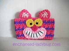 Free Crochet Cheshire Cat coffee cup cozy pattern by The Enchanted Ladybug