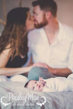 I like this, but think it would be better if both parents were admiring baby.