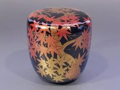 Japanese lacquered tea box or caddy (Usucha-ki or natsume) for holding the powdered tea used in tea ceremony, gold & silver dust stylized maple leaves on black, lacquered wood, Japan