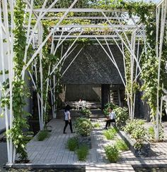 Situated next to an auto mechanic in Vietnam, a verdant outdoor seating area by Cong Sinh Architects provides both a vegetable garden and ample space for respite. : Hiroyuki Oki. @sandow... - Interior Design Ideas, Interior Decor and Designs, Home Design Inspiration, Room Design Ideas, Interior Decorating, Furniture And Accessories