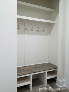 Mudroom in a new construction home. This was originally supposed to be a closet in the laundry room, but the owners asked that the doors not be installed as they knew they wanted a bench instead. Good choice! #homecloset