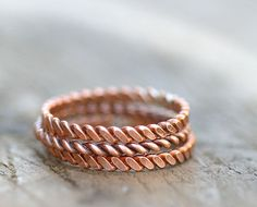 Twisted copper stacking rings by monkeysalwayslook >> I own this trio and I LOVE it - goes with everything, wear one or wear them all! They are beautifully crafted and the artist clearly takes her time with each piece! LOVE!