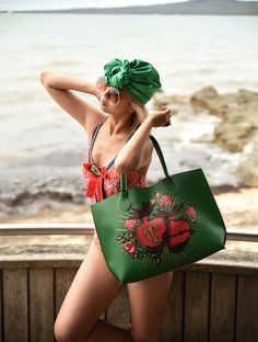 Aki from The Sleek Avenue photographing Moontide swimwear one piece swimsuit, accessorising with some Gucci jewellery, emerald green turban Trelise Cooper beach tote bag. Love summer!
