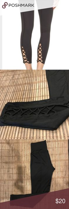 Black athletic pants with criss cross on back Black athletic pants with criss cross detail on back. Never been worn Pants Leggings