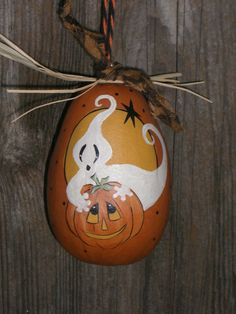 This is a hand painted halloween gourd ornament .This is 3  tall. has a cord to hang . PAINTED IN ACRYLICS AND SEALED IN A VARNISH . THIS CAN BE