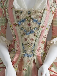 Detail stomacher, robe à la francaise, France, c. 1775, fabric: Spain. Cream green and pink striped silk embroidered with floral garlands, decorated with silk chenille, linen lining. #ModeFranceStyle