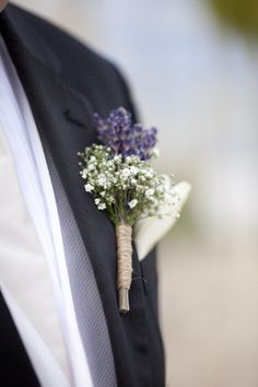 Lavender and Babys Breath boutonniere - tied with jute.