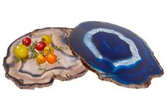 Made from agate forged inside ancient volcanic tunnels, then crafted by artisans in Brazil, these hand-polished platters are ideal for displaying hors d'oeuvres or artisanal cheeses. This is a natural