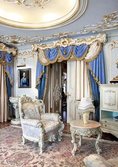 The whimsical combination of light pastel blueand gold of this room screams Rococo Style from the 18th Century. The heavily ornate and curvaceous furnitures represent the Rococo Style: the Cabriole Legs, the Bergere Chair. Stucco wall and ceiling also represent the Rococo Style. More
