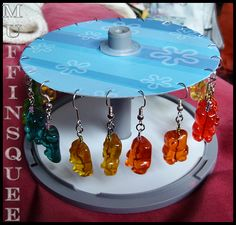 DIY CD Spindle Earring Stands. Here are a few inspirations on reusing CD's as earring holders.