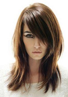 Great medium layers on warm dark blonde, light brunette coloring. Brown cut color hair