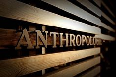 Anthropologie sign in slat wall