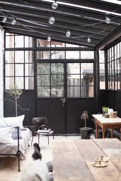 we love the dark walls and abundance of light in this conservatory! imagine what it would look like full of plants! Interior Architecture, Interior And Exterior, Minimalism Living, Loft Industrial, Home Decoracion, Deco Design, Design Design, My New Room, Conservatory